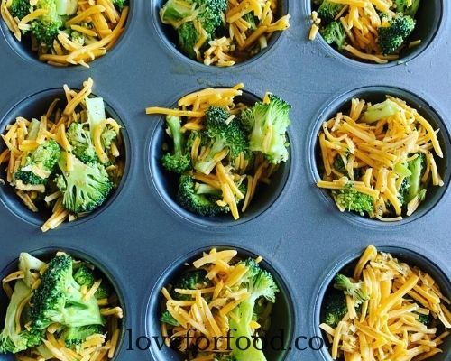 Broccoli and cheese mixture in a muffin pan