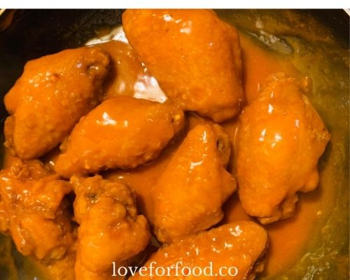 Spicy chicken wings coated in hot buffalo sauce